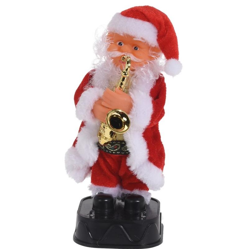 Bewegende kerstfiguren dansende kerstman met gitaar 20 cm
